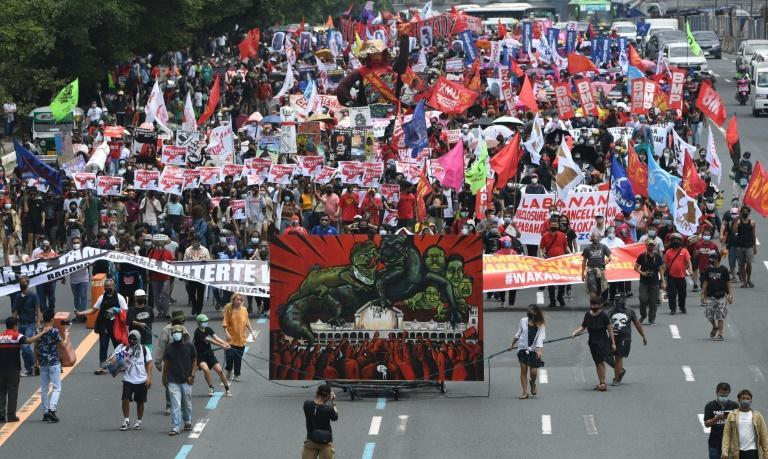 Thousands of protesters marched along a major avenue demanding an end to Duterte's presidency