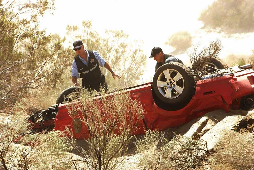 """Grissom and Nick discover the car that Sara was trapped under in the desert. (""""Dead Doll"""" 9/27/2007, Season 8 Premiere)"""