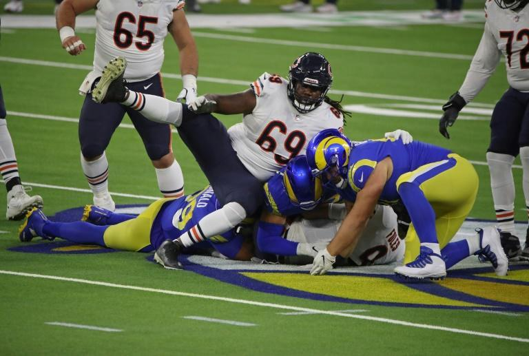 Chicago Bears quarterback Nick Foles, 9, is tackled by Aaron Donald, 99, and Greg Gaines, 91, of the Los Angeles Rams during the second quarter of the Rams 24-10 win in Los Angeles, California