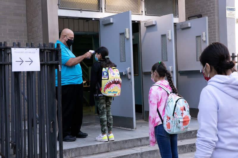 U.S. schools in suburbs, small cities reopening without COVID spike; big cities up next