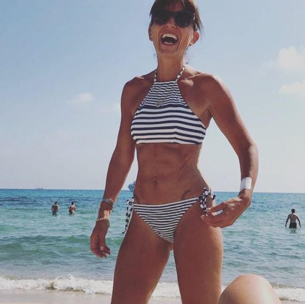 Davina's got good reason to laugh: her abs are just getting better with age. Photo: Instagram