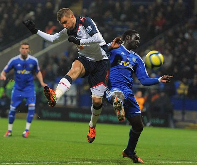 "Bolton Wanderers' Croatian forward Ivan Klasnic (L) vies with Macclesfield Town's Guinean midfielder Arnaud Mendy during the English FA Cup third round reply football match between Bolton and Macclesfield at The Reebok stadium, Bolton, north-west England on January 17, 2012. (Photo by Andrew Yates. Restricted To Editorial Use. No Use With Unauthorized Audio, Video, Data, Fixture Lists, Club/league Logos Or ""live"" Services. Online In-match Use Limited To 45 Images, No Video Emulation. No Use In Betting, Games Or Single Club/league/player Publications./AFP/Getty Images)"