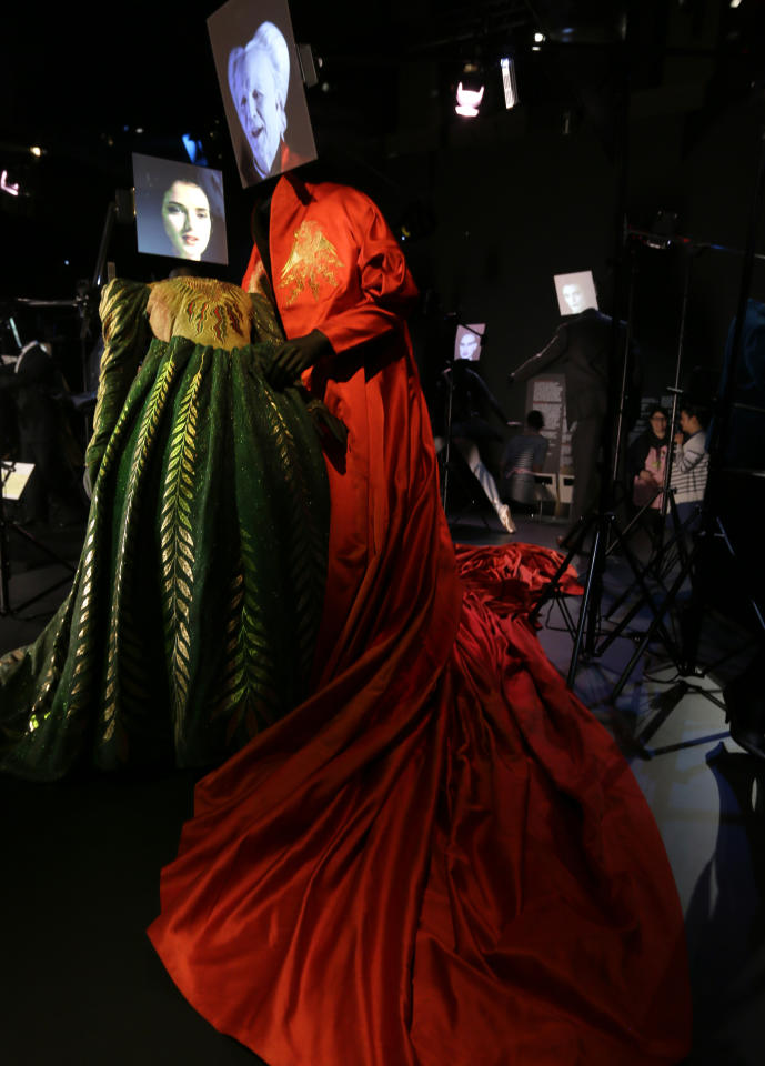 Two costumes made for the 1992 film Bram Stoker's Dracula, by designer Eiko Ishioka, showing a dress worn by the characters Mina Murray/ Elizabeth played actress Winona Ryder and the red cape worn by Count Dracula played by actor Gary Oldman on display at the Hollywood Costume exhibition at the Victoria and Albert museum in London, Tuesday, Oct. 16, 2012. The show at the Victoria and Albert Museum showcases more than one hundred movie costumes from a century of film-making. The exhibition opens to the public on Oct. 20, 2012 and run till 27 Jan. 2013. (AP Photo/Alastair Grant)