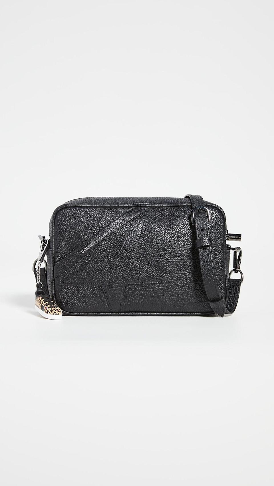 <p>This <span>Golden Goose Star Bag</span> ($530) is what we call classic with a twist, and we're very into it. How cute is the sneaker charm?</p>
