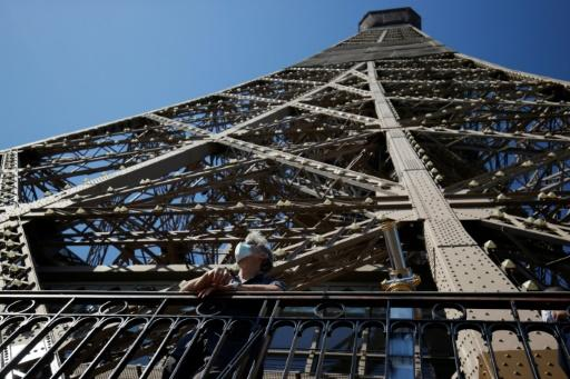 As the Eiffel Tower reopens after 104 days of coronavirus lockdown, elevators and the top observation deck remain off-limits because of social distancing concerns