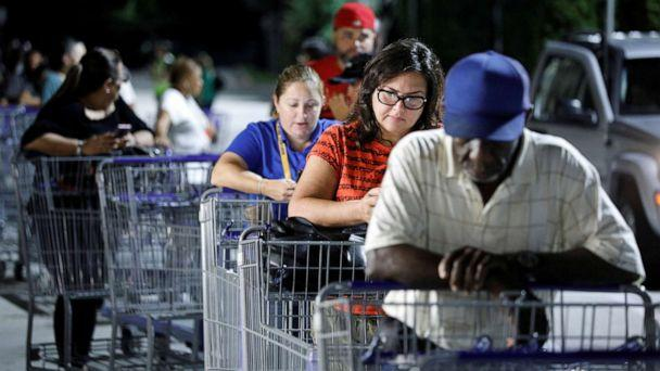 PHOTO: Shoppers wait in line for a Sam's Club store to open before sunrise, as people rushed to buy supplies ahead of the arrival of Hurricane Dorian in Kissimmee, Fla., Aug. 30, 2019. (Gregg Newton/Reuters)