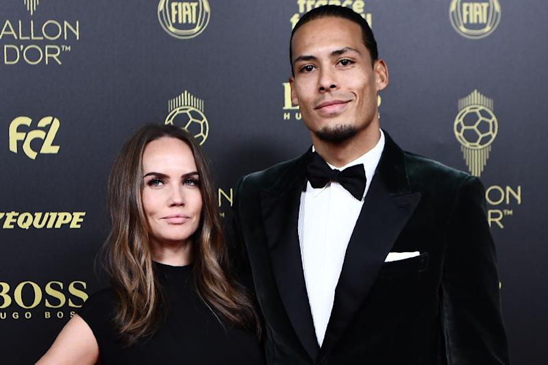 Liverpool's Dutch defender Virgil van Dijk and his wife Rike Nooitgedagt (L) arrive to attend the Ballon d'Or France Football 2019 ceremony at the Chatelet Theatre in Paris on December 2, 2019. (Photo by Anne-Christine POUJOULAT / AFP) (Photo by ANNE-CHRISTINE POUJOULAT/AFP via Getty Images)