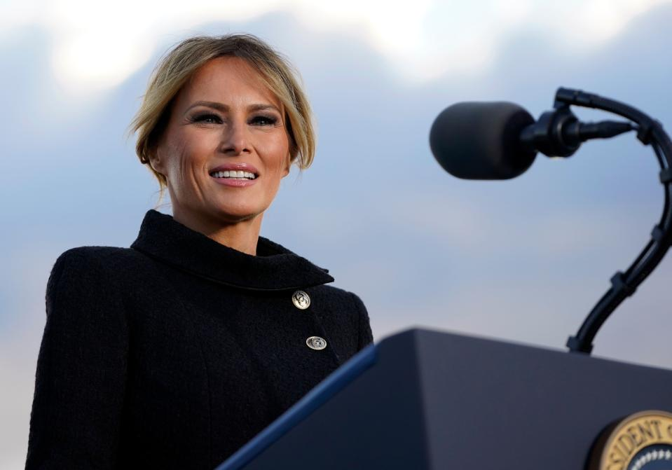 US First Lady Melania Trump speaks before boarding Air Force One at Joint Base Andrews in Maryland on January 20, 2021. - US President Donald Trump travels to his Mar-a-Lago golf club residence in Palm Beach, Florida, and will not attend the inauguration for President-elect Joe Biden.