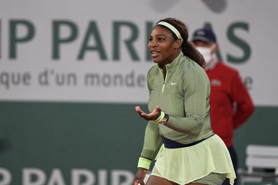 United States Serena Williams challenges a line call with the umpire as she plays against Romania's Irina-Camelia Begu during their first round match on day two of the French Open tennis tournament at Roland Garros in Paris, France, Monday, May 31, 2021. (AP Photo/Michel Euler)
