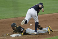 Pittsburgh Pirates' Jarrod Dyson slides safely into second base for a steal as Cleveland Indians' Cesar Hernandez can't get to the ball in the fifth inning during a preseason baseball game, Monday, July 20, 2020, in Cleveland. Dyson advanced to third base on the play. (AP Photo/Tony Dejak)