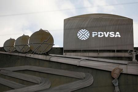 FILE PHOTO: Cutouts depicting images of oil operations are seen outside a building of Venezuela's state oil company PDVSA in Caracas