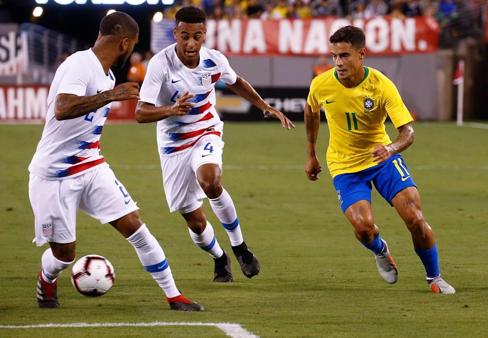 EAST RUTHERFORD, NJ - SEPTEMBER 07: DeAndre Yedlin #2 of USA and Tyler Adams #4 of USA defend Philippe Coutinho #11 of Brazil during their friendly match at MetLife Stadium on September 7, 2018 in East Rutherford, New Jersey. (Photo by Jeff Zelevansky/Getty Images)