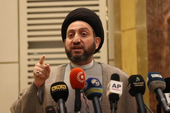 Shiite leader Ammar al-Hakim, addresses a gathering to commemorate five years since IS carried out coordinated attacks on a number of Yazidi Iraqi villages, in Baghdad, Iraq, Thursday, Aug. 1, 2019. Yazidi community leaders and Iraqi politicians said that despite the military defeat of the IS, the religious minority attacked and enslaved by the extremists still lives in disarray, mostly in camps and with no security in their still-ruined hometowns. The speakers gathered in Baghdad on Thursday to commemorate five years since the IS attacks, massacring men and enslaving women and children in what has been described as genocide. (AP Photo/Hadi Mizban)