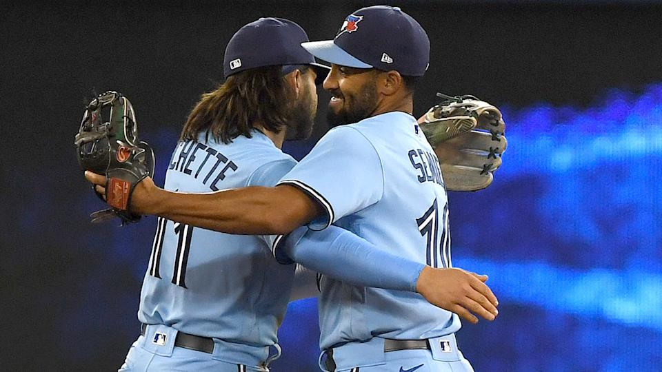 Blue Jays shortstop Bo Bichette (11) and second baseman Marcus Semien (10) embrace as they celebrate a win over the New York Yankees at Rogers Centre. (Dan Hamilton-USA TODAY Sports)