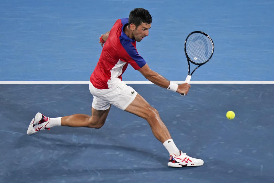 Novak Djokovic, of Serbia, plays Kei Nishikori, of Japan, during the quarterfinals of the tennis competition at the 2020 Summer Olympics, Thursday, July 29, 2021, in Tokyo, Japan. (AP Photo/Seth Wenig)
