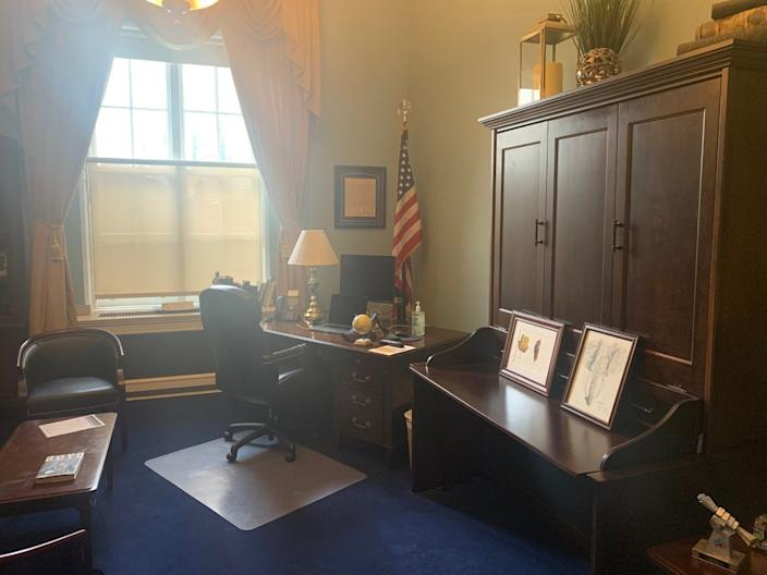 A photo of the mahogany cabinet in Rep. Ted Budd's office that doubles as a Murphy bed. Budd is one of an estimated 100 lawmakers who sleep in their Capitol Hill offices when they are in Washington, D.C., a practice that is getting scrutiny amid the coronations
