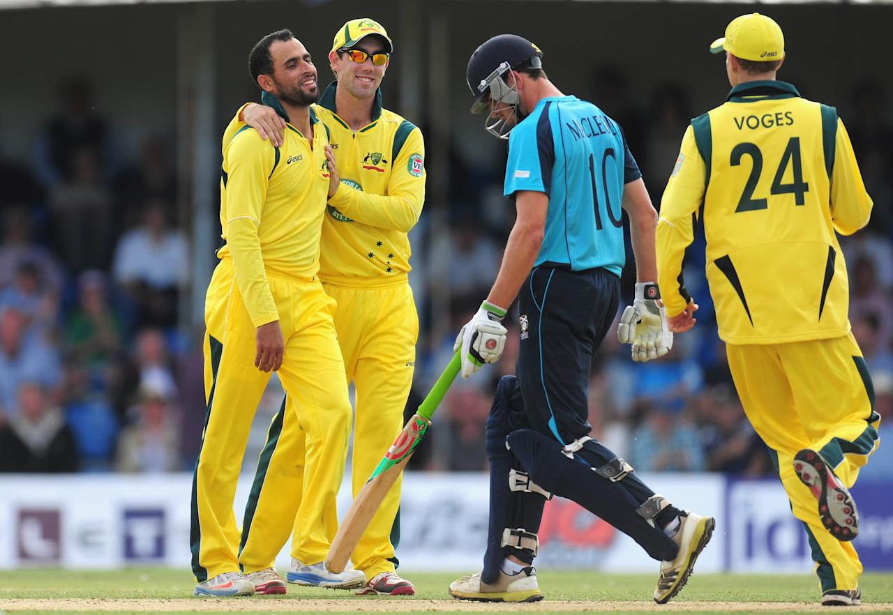 EDINBURGH, SCOTLAND - SEPTEMBER 03:  Australia bowler Fawad Ahmed (l) celebrates with Glenn Maxwell after dismissing Scotland batsman Calum Macleod during the One Day International between Scotland and Australia at the Grange on September 3, 2013 in Edinburgh, Scotland.  (Photo by Stu Forster/Getty Images)