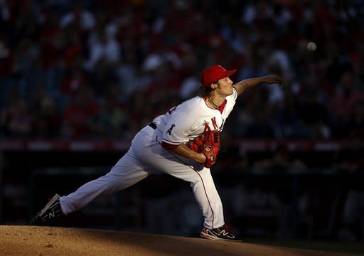 Los Angeles Angels starting pitcher C.J. Wilson throws against the Baltimore Orioles in the first inning of a baseball game in Anaheim, Calif., Friday, July 6, 2012. (AP Photo/Jae C. Hong)