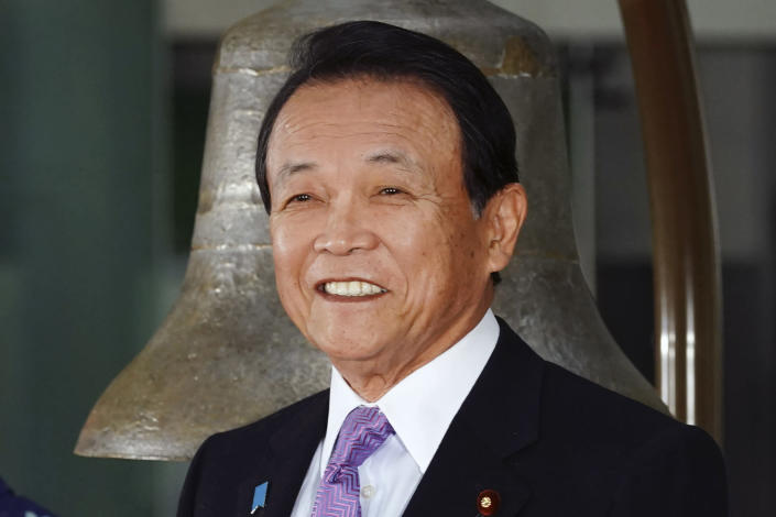 FILE - In this Jan. 6, 2020, file photo, Japan's Finance Minister Taro Aso poses during a ceremony marking the start of this year's trading in Tokyo. Japan's gaffe-prone finance minister Aso came under fire, this time for praising Japan for what he says is the world's only country of single race, language and monarchy that lasted for 2,000 years - a remark that invited criticisms that he neglected Japanese indigenous ethnic group of Ainu and the reality of more racially diverse population elsewhere. (AP Photo/Eugene Hoshiko, File)