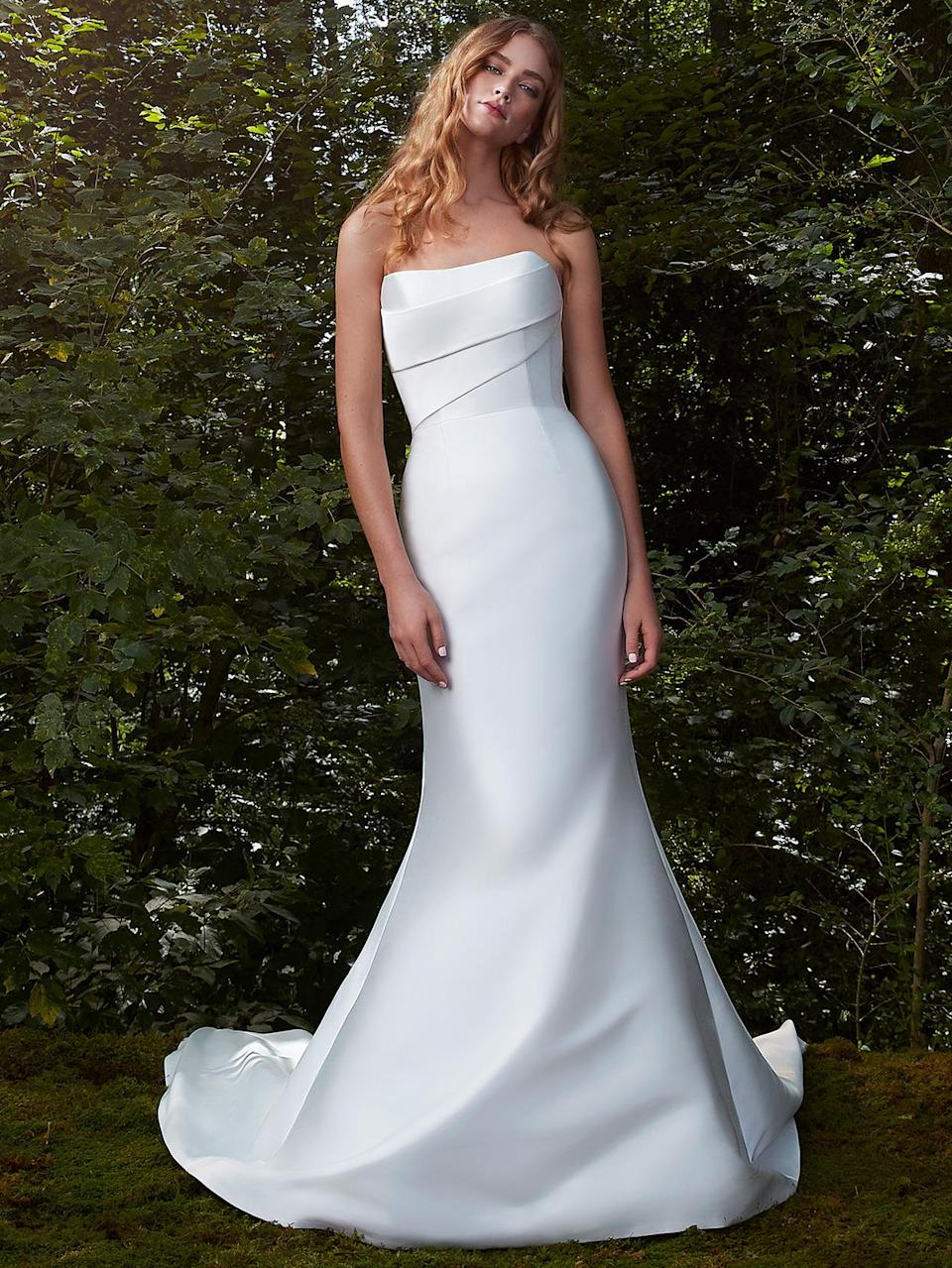 "<p>In a time of great uncertainty, the Anne Barge Fall 2021 wedding dress collection offers a welcome retreat. The just-debuted series ""is a haven of tranquility,"" reads the label's press release, and offers some ""serenity <a href=""https://www.marthastewart.com/7868538/coronavirus-covid19-wedding-planning"" rel=""nofollow noopener"" target=""_blank"" data-ylk=""slk:during a year of unprecedented challenges"" class=""link rapid-noclick-resp"">during a year of unprecedented challenges</a>."" Like so many of us, Barge turned to nature—where the Atlanta-based creative spent her time in quarantine surrounded by the bountiful greenery in her home state of Georgia—for solace and inspiration while ideating <a href=""https://www.marthastewart.com/600304/wedding-dresses"" rel=""nofollow noopener"" target=""_blank"" data-ylk=""slk:each and every gown"" class=""link rapid-noclick-resp"">each and every gown</a>. It makes sense, then, that the final creations are symbols of ""prosperity, freshness, and growth.""</p> <p>Nature-driven details are woven throughout this collection of dreamy gowns, composed of the finest Italian Mikado scuba, oversized floral Chantilly lace, and charmeuse fabrics. Whimsical motifs, like embroidered organza blossoms with petite beaded blooms, 3D floral vines, and fall foliage appliqués, speak to the more organic side of the collection—which <em>does</em>, however, have a daring facet. The more avant-garde ensembles feature plunging V-necklines and <a href=""https://www.marthastewart.com/7947831/wedding-dress-shopping-tips"" rel=""nofollow noopener"" target=""_blank"" data-ylk=""slk:exaggerated dropped waist"" class=""link rapid-noclick-resp"">exaggerated dropped waist</a> silhouettes, delivering on the subtle, but sexy factor the brand is known for. Like Mother Nature, both sides of the series work together, achieving a unique balance—and ensuring that there is something available for just about any bride-to-be, <a href=""https://www.marthastewart.com/7903644/when-start-shopping-wedding-dress"" rel=""nofollow noopener"" target=""_blank"" data-ylk=""slk:whatever her style"" class=""link rapid-noclick-resp"">whatever her style</a>.</p> <p>On the whole, the Anne Barge Fall 2021 bridal collection feels like a walk through the woods or a breath of fresh air—and is perfect for any woman planning a <a href=""https://www.marthastewart.com/7922867/fall-ideas-real-weddings"" rel=""nofollow noopener"" target=""_blank"" data-ylk=""slk:future fall event"" class=""link rapid-noclick-resp"">future fall event</a>, in particular. Natural motifs and symbolism aside, these numbers are simply beautiful and painstakingly crafted. Discover them for yourself in the slides ahead.</p>"