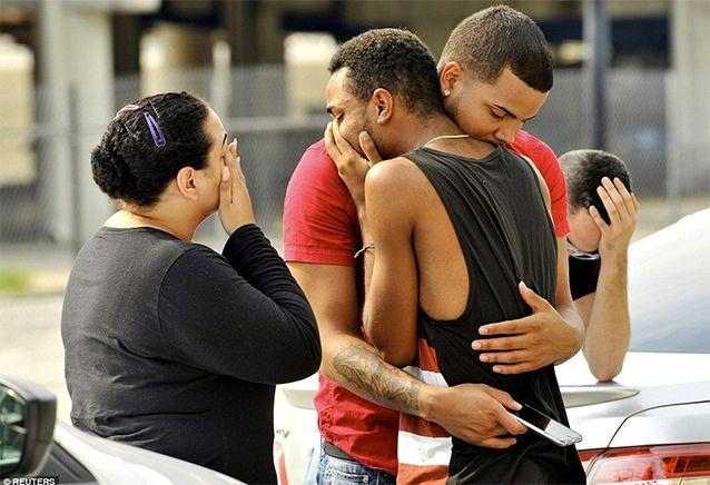 Mourners embrace in grief after the 'worst mass shooting in US history'. Photo: Getty