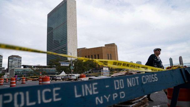 PHOTO: A pedestrian passes police barricades surrounding the United Nations headquarters as 1st Avenue is partially shut down to unofficial traffic, Sept. 22, 2021, during the 76th Session of the U.N. General Assembly in New York City. (John Minchillo/AP)
