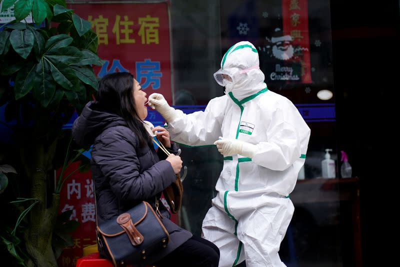 FILE PHOTO: Reuters reporter Brenda Goh receives a nucleic acid test for COVID-19 in Wuhan