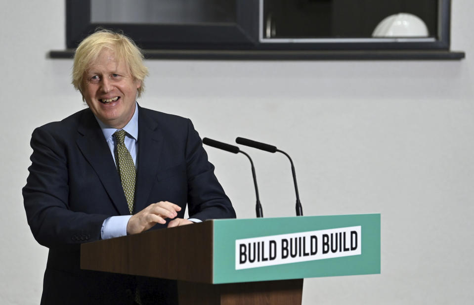 Britain's Prime Minister Boris Johnson listens to a question, during a visit to Dudley College of Technology in Dudley, England, Tuesday June 30, 2020. Johnson promised an infrastructure investment plan to help the U.K. fix the economic devastation caused by the pandemic. (Paul Ellis/Pool Photo via AP)