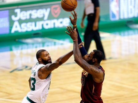 May 15, 2018; Boston, MA, USA; Boston Celtics forward Marcus Morris (13) defends Cleveland Cavaliers forward LeBron James (23) during the third quarter of game two of the Eastern conference finals of the 2018 NBA Playoffs at TD Garden. Mandatory Credit: Greg M. Cooper-USA TODAY Sports