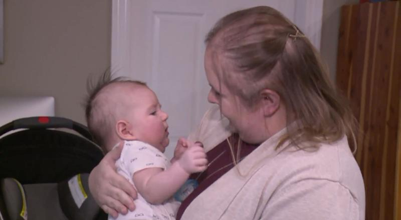 Emily Manley carries her three-month-old baby Jettson. (Credit: ABC13)