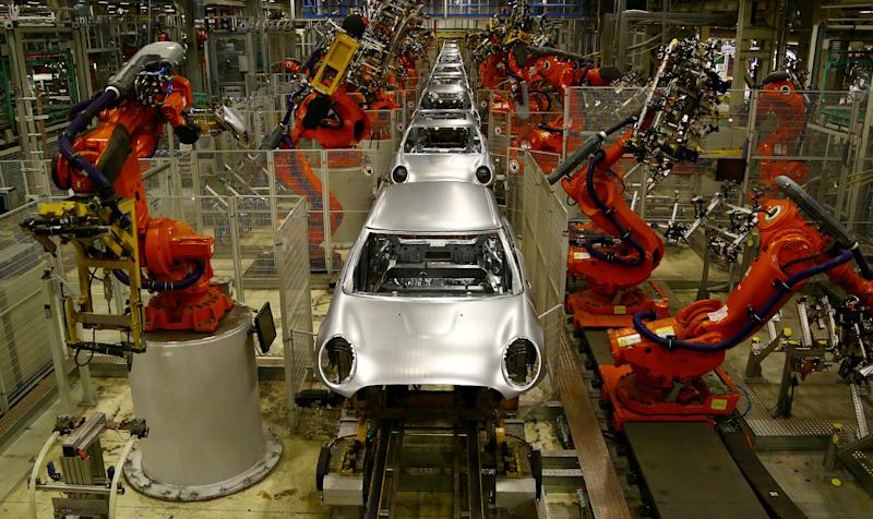 Automated production line at the BMW Mini car production plant in Oxford, England. Photo: Geoff Caddick/AFP/Getty Images