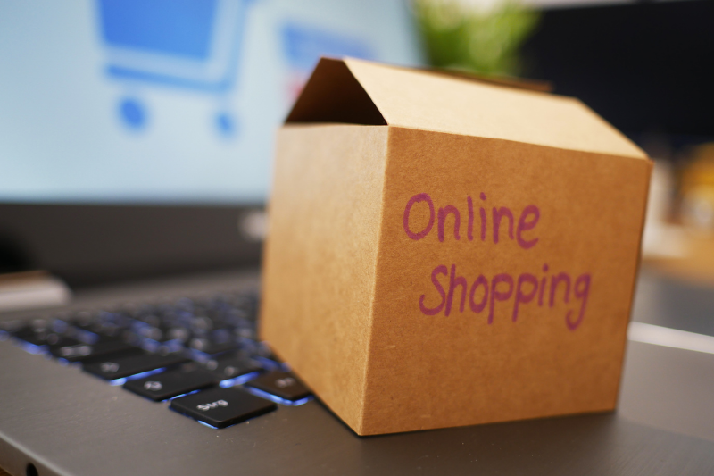 Box with Online Shopping Sitting on Keyboard
