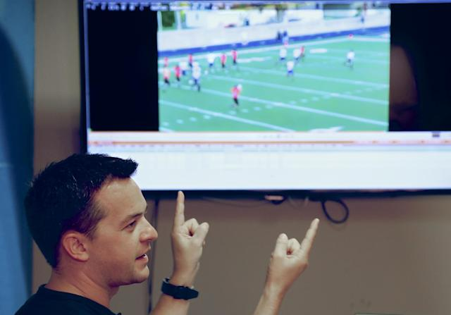 In this photo from Aug. 14, 2014, John Wirtz, Chief Product Officer of Hudl, speaks of his company's product in Lincoln, Neb. Hudl is a software company that has developed a way to immediately get game film to coaches after games and break down and separate different plays by type. (AP Photo/Nati Harnik)