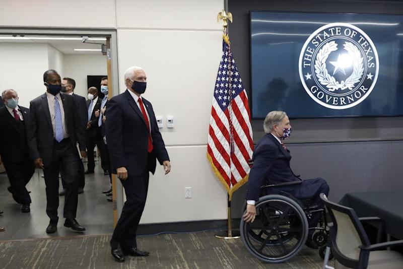 Greg Abbott, right, is followed by Vice-President Mike Pence and housing secretary Ben Carson as they arrive for a news conference last month.