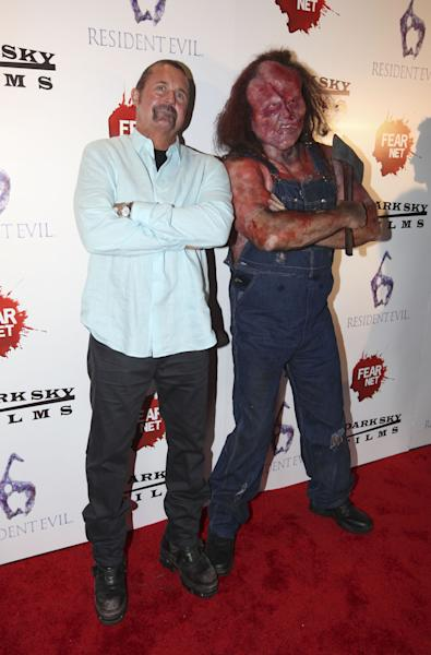 COMMERCIAL IMAGE - From left, Kane Hodder and Hatchet Man arrive to the Fear Net and Resident Evil Party at Voyeur Nightclub for Comic-Con weekend on Friday July 13, 2012, in San Diego. (Photo by Jeff Bottari/Invision for MPI/Dark Sky Films/AP Images)