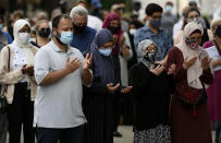 <p>People raise their hands in prayer at a vigil for the four family members who were killed in a vehicle attack that police say was motivated by anti-Muslim hate, in London, Ont., in Ottawa, on Tuesday, June 8, 2021. THE CANADIAN PRESS/Justin Tang</p>