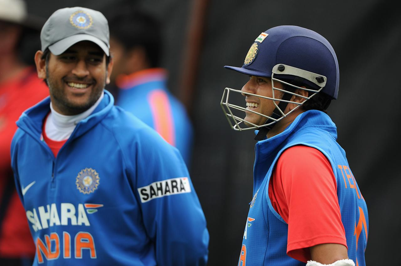 CHESTER-LE-STREET, ENGLAND - SEPTEMBER 02: Captain MS Dhoni (R) and Sachin Tendulkar of India smile during a nets session at The Riverside on September 2, 2011 in Chester-le-Street, England.  (Photo by Gareth Copley/Getty Images)