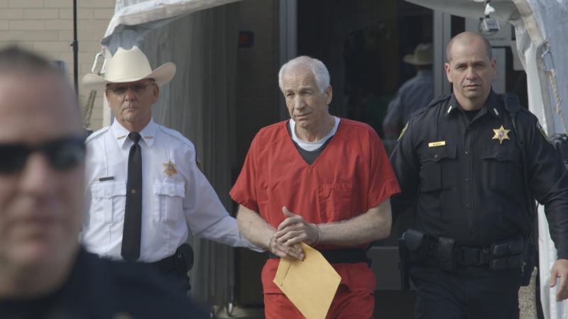 "This photo provided by the Sundance Institute shows Jerry Sandusky, center, in the documentary film, ""Happy Valley,"" by director Amir Bar-Lev. The Sundance Film Festival runs Jan. 16-26, 2014, in Park City, Utah. (AP Photo/Sundance Institute, Asylum Entertainment)"