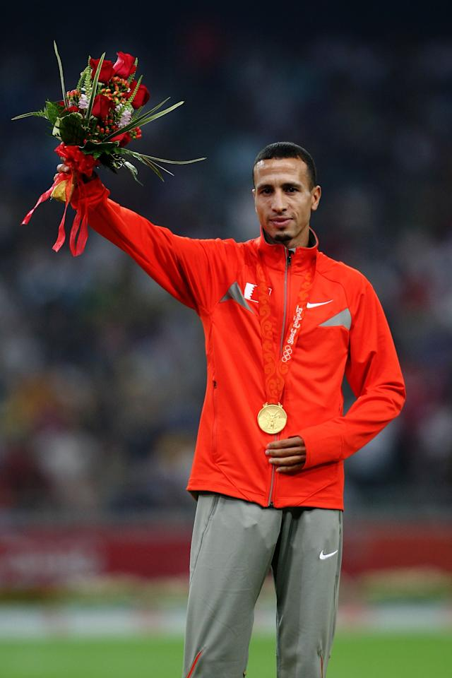 BEIJING - AUGUST 20:  Rasheed Ramzi of Bahrain poses after winning a gold medal in the men's 1500m track and field athletics event at the National Stadium during Day 12 of the Beijing 2008 Olympic Games on August 20, 2008 in Beijing, China.  (Photo by Lars Baron/Bongarts/Getty Images)