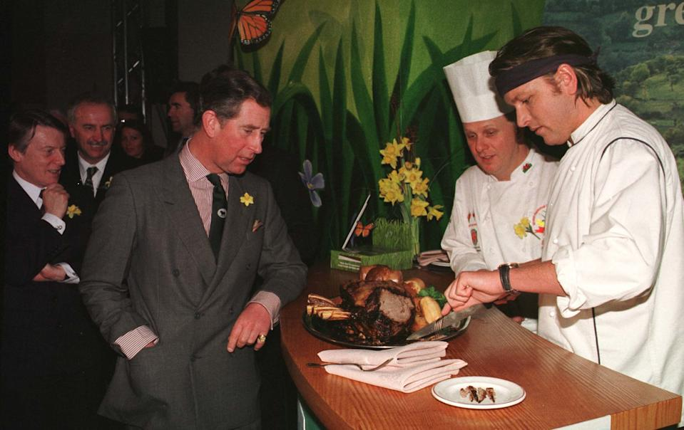 "The Prince of Wales with James Martin (R) of ""Ready Steady Cook"" and Trevor Jones the Head Chef of Celtic Manor before tasting Welsh Beef during his visit to Newport. Prince Charles launched a campaign promoting Welsh beef and lamb."
