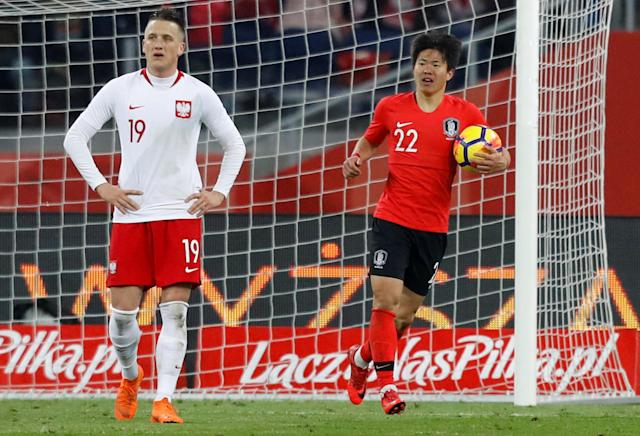 Soccer Football - International Friendly - Poland vs South Korea - Silesian Stadium, Chorzow, Poland - March 27, 2018 South Korea's Kwon Chang-hoon celebrates after teammate Hwang Hee-chan scores their second goal REUTERS/Kacper Pempel