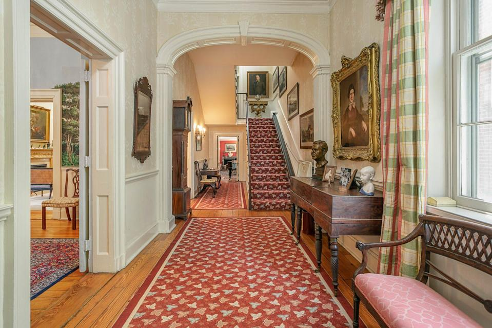 <p>Talk about an entrance! Oversized windows and nearly 12-foot ceilings create a bright, airy vibe throughout the home. And those moldings? Incredible.</p>