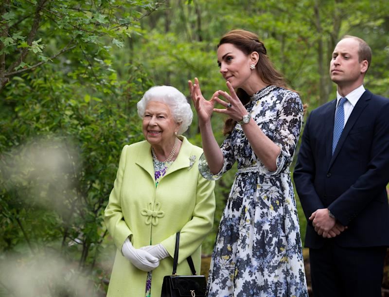 RHS Chelsea Flower Show Queen Elizabeth II, Prince William and Kate, Duchess of Cambridge observe the garden.