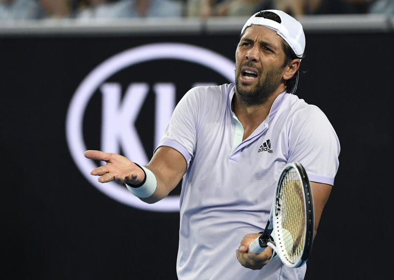 Spain's Fernando Verdasco reacts after losing a point to Germany's Alexander Zverev during their third round singles match at the Australian Open tennis championship in Melbourne, Australia, Saturday, Jan. 25, 2020. (AP Photo/Andy Brownbill)