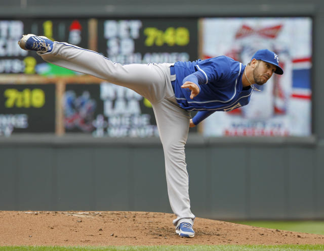 Kansas City Royals starting pitcher James Shields follows through with a pitch during the first inning of a baseball game agains the Minnesota Vikings in Minneapolis, Saturday, April 12, 2014. (AP Photo/Ann Heisenfelt)