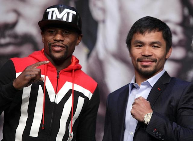 Floyd Mayweather Jr. and Manny Pacquiao pose during Wednesday's news conference in Las Vegas. (AFP)