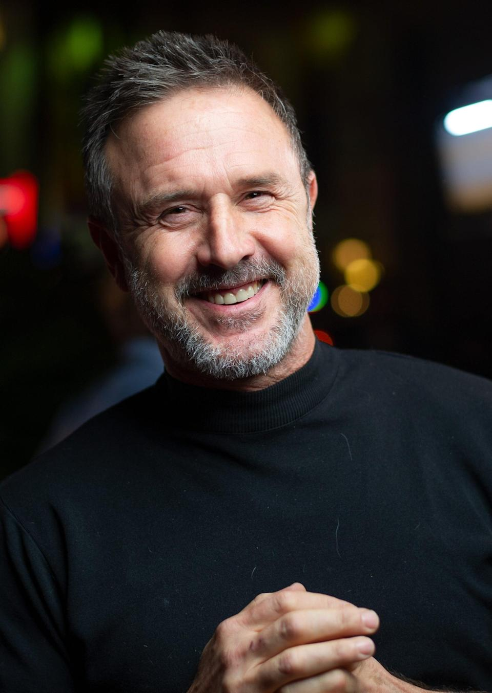 """<p><a href=""""https://www.hollywoodreporter.com/heat-vision/david-arquette-back-as-dewey-riley-spyglass-scream-relaunch-1294991"""" class=""""link rapid-noclick-resp"""" rel=""""nofollow noopener"""" target=""""_blank"""" data-ylk=""""slk:Arquette was the first official member of the cast"""">Arquette was the first official member of the cast</a>, with news of his return breaking on May 18. """"I am thrilled to be playing Dewey again and to reunite with my <strong>Scream</strong> family, old and new,"""" he said in a statement. """"<strong>Scream</strong> has been such a big part of my life, and for both the fans and myself, I look forward to honoring Wes Craven's legacy.""""</p>"""