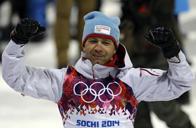 Norway's Ole Einar Bjoerndalen celebrates after clinching the gold medal in the men's biathlon 10k sprint, at the 2014 Winter Olympics, Saturday, Feb. 8, 2014, in Krasnaya Polyana, Russia. (AP Photo/Kirsty Wigglesworth)