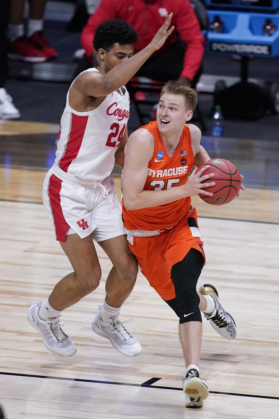 Syracuse guard Buddy Boeheim (35) drives against Houston guard Quentin Grimes (24) in the first half of a Sweet 16 game in the NCAA men's college basketball tournament at Hinkle Fieldhouse in Indianapolis, Saturday, March 27, 2021. (AP Photo/Michael Conroy)