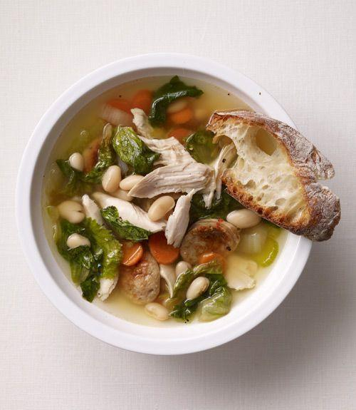 """<p>Though the recipe calls for escarole, frozen spinach makes a more-than-adequate substitute, giving the dish a mild flavor all its own.</p><p><strong><a href=""""https://www.countryliving.com/food-drinks/recipes/a33098/chicken-soup-with-smoked-sausage-white-beans-and-greens-recipe/"""" rel=""""nofollow noopener"""" target=""""_blank"""" data-ylk=""""slk:Get the recipe"""" class=""""link rapid-noclick-resp"""">Get the recipe</a>.</strong></p>"""